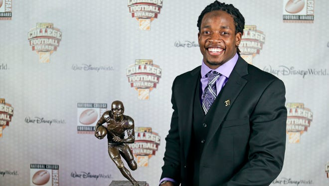 Wisconsin's Melvin Gordon stands with his trophy after being named the winner of the Doak Walker Award as the nation's premier running back at the College Football Awards.