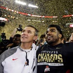 Ohio State coach Urban Meyer, left, and Ezekiel Elliott celebrate after winning the inaugural College Football Playoff championship in January.