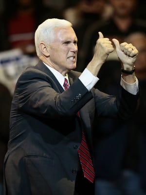"""Vice President-elect Mike Pence takes the state at Donald Trump's """"USA Thank You Tour"""" at U.S. Bank Arena Thursday."""