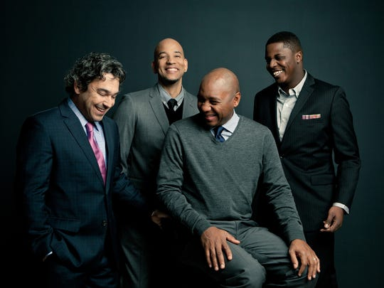 The Branford Marsalis Quartet includes (from left) pianist Joey Calderazzo, bassist Eric Revis, Marsalis and drummer Justin Faulkner.