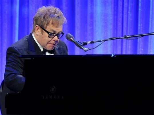 Sir Elton John performs at the Ninth Annual Elton John AIDS Foundation benefit 'An Enduring Vision' at Cipriani Wall Street in 2010 in New York. (AP Photo / Evan Agostini)
