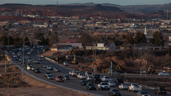 Rush hour traffic moves through the intersection of 1450 S. River Road in St. George.