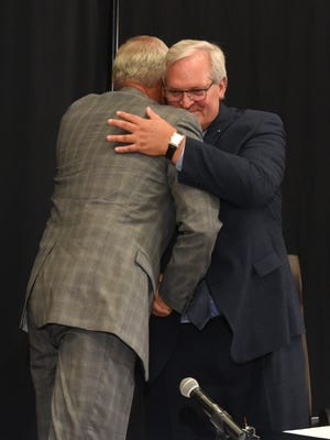 Kelby Krabbenhoft, president and CEO of Sanford Health, (left) and David J. Horazdovsky, president and CEO of the Evangelical Lutheran Good Samaritan Society, hug after the press conference at the Sheraton Sioux Falls & Convention Center in Sioux Falls, S.D. Tuesday, June 26, 2018.