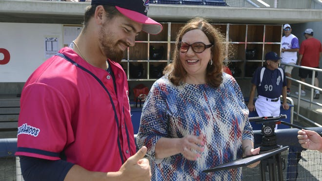 Southern League commissioner Lori Webb, speaks to Kyle McMyne,the Southern League Relief Pitcher of the Month Sunday before the start of the Blue Wahoos game at Pensacola Bayfront Stadium.