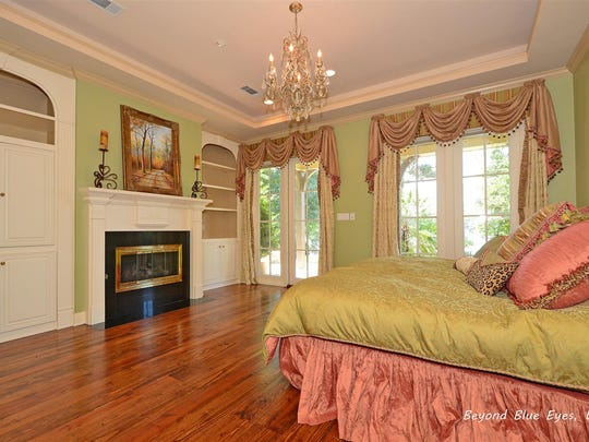 There is a fireplace in the master bedroom.