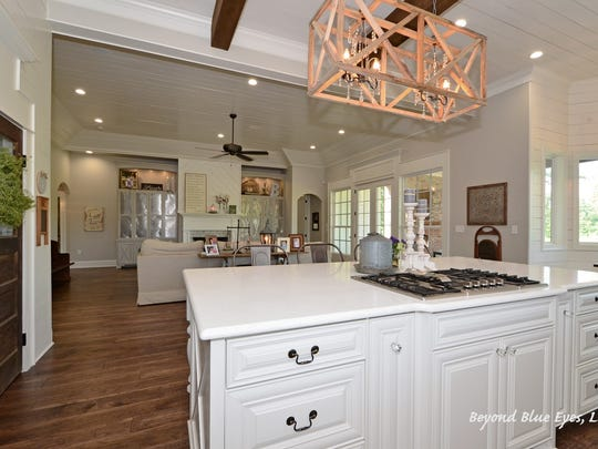The kitchen at 1441 Suwannee Lane features exposed wood beams.
