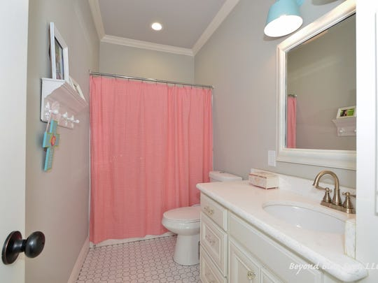 Ther are four full and seven partial bathrooms at 1441 Suwannee Lane in Benton.