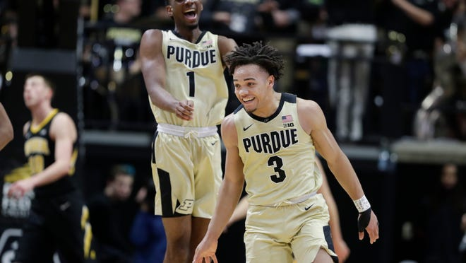Purdue guard Carsen Edwards (3) and forward Aaron Wheeler (1) celebrate a basket against Iowa during the first half of an NCAA college basketball game in West Lafayette, Ind., Thursday, Jan. 3, 2019. (AP Photo/Michael Conroy)