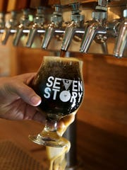 THE PHOTO:  Casey Dunlavey, Seven Story Brewing co-owner, pours a pint of their porter beer at their new brewery in Perinton.  FROM SHAWN:  A small light hidden in the bottom right corner helps illuminate the beer as it pours out.  For me, seeing the brewery logo is key.  It helps to immediately identify the location.