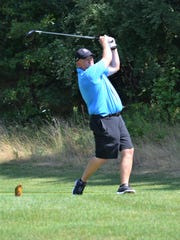 Tony Evans tees off on No. 18 during the City Senior Tournament at Binder Park Golf Course.