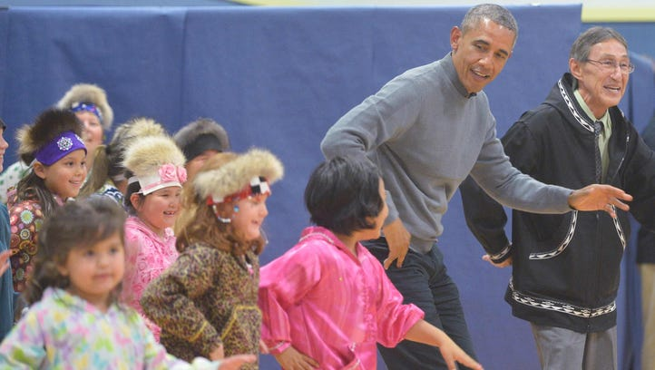 President Obama dances with children after attending