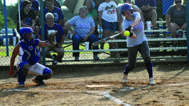 Joleigh Tate is about to make contact with a pitch during a scrimmage in June. Tate and the rest of Booneville's non-school team will play in a tournament in Russellville this weekend.