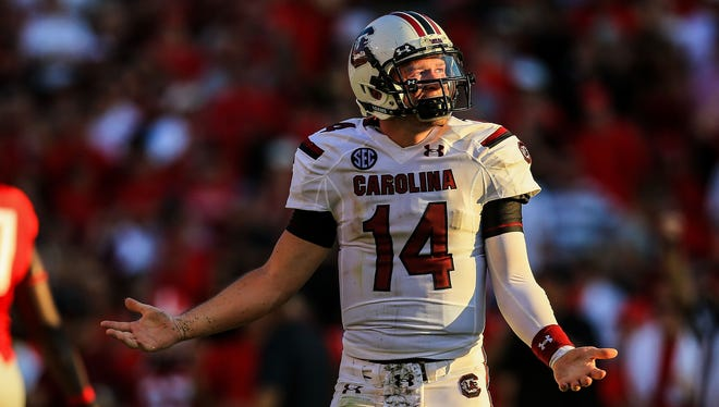 South Carolina quarterback Connor Shaw (14) reacts to a play in the second half of a loss against No. 12 Georgia on Saturday at Sanford Stadium.