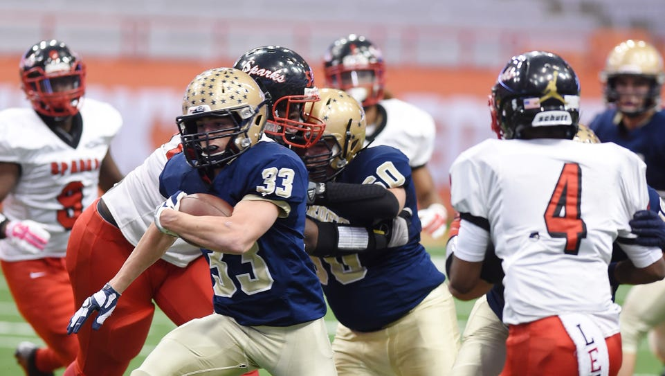 Our Lady of Lourdes High School's Joe Scaglione carries