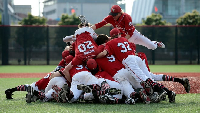The Lancers celebrate after the final out of the seventh inning of the OHSAA Division I Regional Final Baseball game between the La Salle Lancers and the Milford Eagles at Marge Schott Stadium on the campus of the University of Cincinnati, on Friday, May 27, 2016. The Lancers advance to the State Semi finals in Columbus with a 7-1 win over Milford.