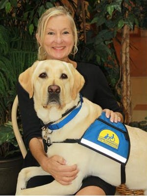Victim/Witness Program Director Janet Balser with dog Murph.