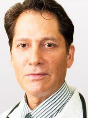 Dr. Manouchehr Refaeian, president of the El Paso Pain
