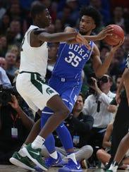 Michigan State's Jaren Jackson Jr. defends against