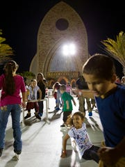 Participants skate on a faux ice skating rink at the annual Celebration of Lights in Ave Maria on Dec. 2, 2016. The holiday event featured a town parade, a faux ice skating rink, activities, photos with Santa, and live performances by local schools and organizations.