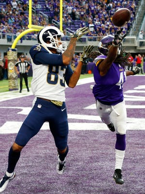 Minnesota Vikings strong safety Anthony Harris, right, breaks up a pass intended for Los Angeles Rams wide receiver Josh Reynolds, left, during the second half of an NFL football game, Sunday, Nov. 19, in Minneapolis.