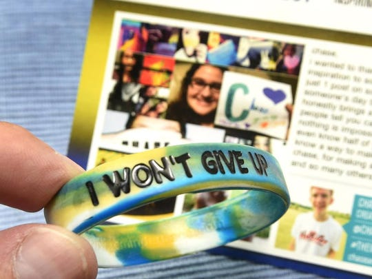 """A wristband Woodbridge High School senior Chase Marvil sells to victims of bullying as part  """"The Inspiring Project."""""""