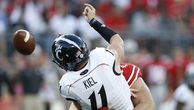 UC quarterback Gunner Kiel fumbles as he is hit by Ohio State's Joey Bosa in the first quarter Saturday in Columbus.