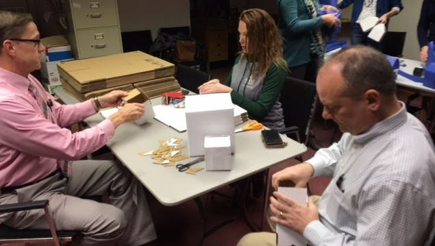 Employees of Haring Realty are making houses and hotels for the upcoming Monolopy floor-size board game on Feb. 23 at the Richland Mall in Ontario. The event is a fundraiser for the United Way of Richland County.