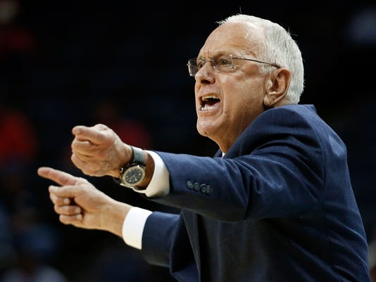 SMU head coach Larry Brown directs his players in the first half of an NCAA college basketball game against Houston at the American Athletic Conference tournament Thursday, March 13, 2014, in Memphis, Tenn. (AP Photo/Mark Humphrey)