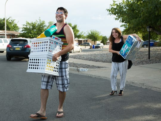 Joel Fisk, left, helps his mother Victoria Fisk, educator of ninth through twelfth grade social studies and ENLACE at New America High School, carry school supplies donated by Las Cruces Moms Tuesday, August 2, 2016. Las Cruces Moms fundraised more than $5,500 with their annual Mix & Mingle event giving away school supplies to teachers for their classrooms.