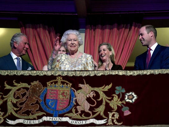 Queen Elizabeth II surrounded by members of the royal