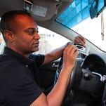 Anthony Arinwine, a San Francisco teacher, drives an Uber to make ends meet.