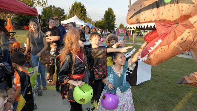 FILE - Children at last year's Trick or Treat So Others Can Eat at Evans Towne Center Park.