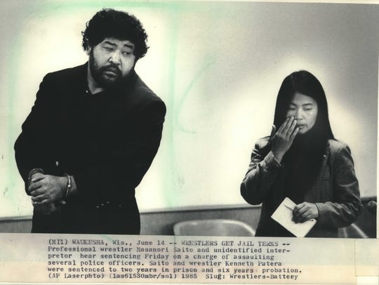 Professional wrestler Masanori Saito (left) and an interpreter hear the judge's sentencing on a charge of assaulting several police officers. Saito and wrestler Ken Patera were sentenced to two years in prison and six years probation. Saito died on July 14 from complications of the Parkinson's disease.