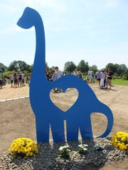 A large, friendly blue dinosaur welcomes visitors to Jack's Place, a playground built in Penfield's Rothfuss Park in memory of 3-year-old Jack Heiligman. Jack loved dinosaurs and the color blue.
