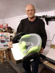 Marty Parzynski with a completed Bella's Bumba. He now builds four different varieties, adapted to children's specific needs, including one with a basket to carry an oxygen tank and other medical devices.
