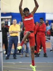 Jadon Watson of Kennedy lifts off the ground en route to clearing 6-8 for second place in the high jump.