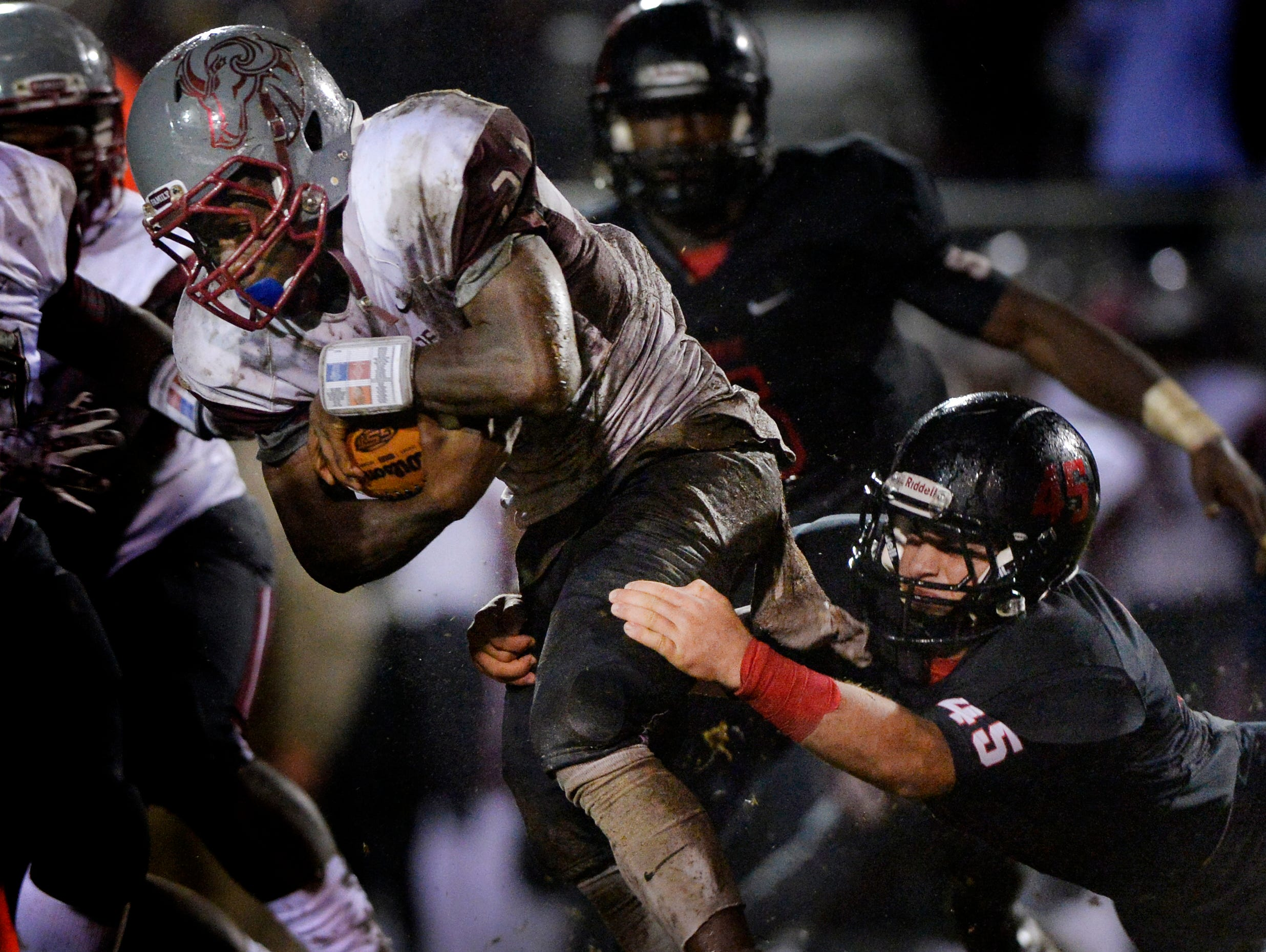 Hillcrest's Keith Humphrey (25) tackles WestsideÕs Quinn Wright (21) late in the second quarter in a Region 1-AAAA game at Hillcrest High School on Friday, October 2, 2015.