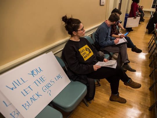 Emma Redden of Burlington listens to Police Chief Brandon