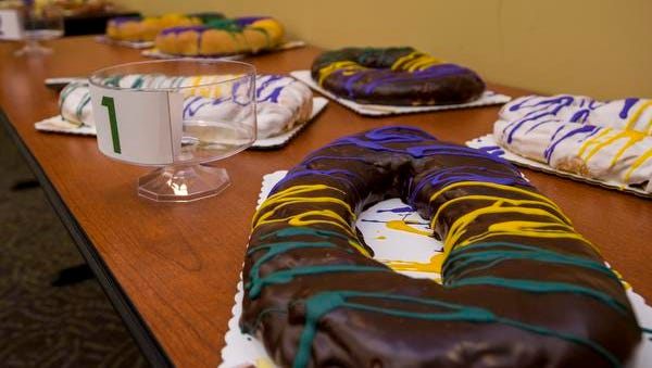 A chocolate covered king cake with Bavarian creme filling is pictured at the Daily Advertiser in Lafayette, LA, Wednesday, Jan. 21, 2015.
