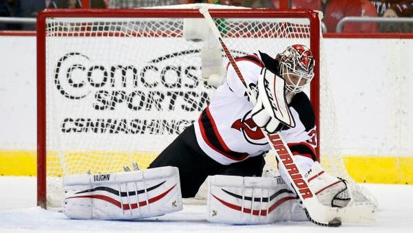 New Jersey Devils goalie Cory Schneider stops the puck during the third period against the Capitals Friday night in Washington.