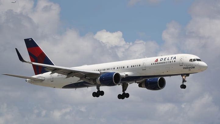 A Delta airlines plane is seen as it comes in for a