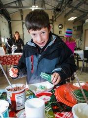 Zachary Smid, 9, of Oconomowoc, decorates a cookie
