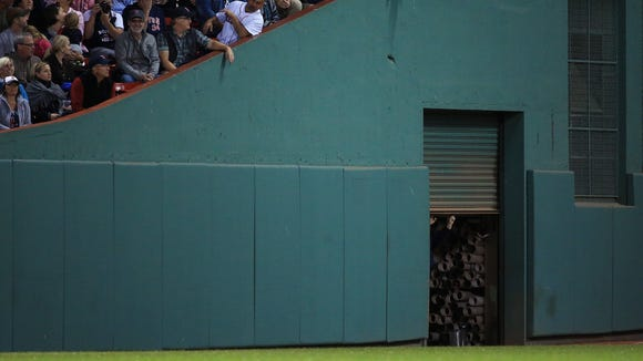 Fans cheer as a door in the outfield is closed after