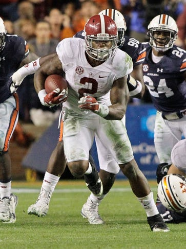 Derrick Henry (2) powered Alabama past Auburn in the