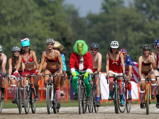 Cyclists make their way down the track during the Grinch's