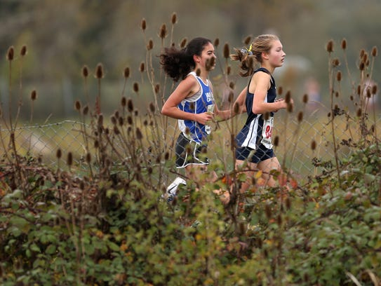 Stayton's Hailey Notman, right, competes in the OSAA