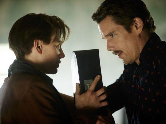 """Sarah Snook (left) and Ethan Hawke appear in a scene from the film """"Predestination."""""""