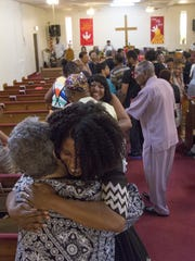 The congregation greets each other at Phillips Memorial