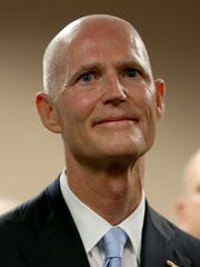 Scott MIAMI, FL - JANUARY 14: Florida Governor Rick Scott as he introduces Carlos Lopez-Cantera as his new lieutenant governor on January 14, 2014 in Miami, Florida. Scott took 10-months to replace Jennifer Carroll, who resigned last March. Lopez-Cantera will be the states first Hispanic lieutenant governor. (Photo by Joe Raedle/Getty Images)