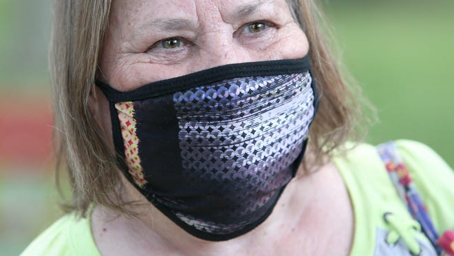 Mary Stewart wears her mask at Price Park in North Canton on Tuesday, June 14, 2020.